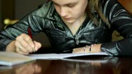 Stock Video Footage of girl doing homework.