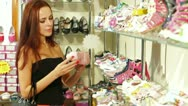 Woman Choosing Footwear in Children's Shoe Store Stock Footage