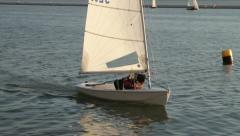 sailor in laser dinghy tacking - stock footage