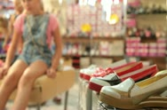 Stock Video Footage of Children Choosing Shoes in Shoe Store