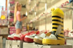 Child Choosing Footwear in Shoe Store Stock Footage