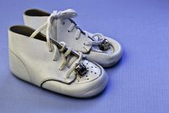 Baby boy's worn shoes Stock Photos