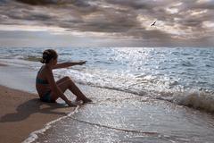 Girl and sea Stock Photos