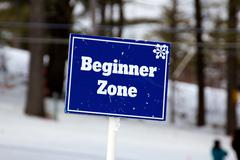 Blue Beginner Zone Sign on the Ski Slopes Stock Photos