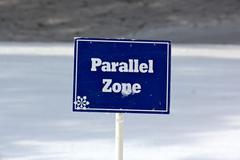 Blue Parallel Zone Sign on the Ski Slopes Stock Photos