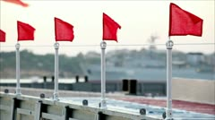 Little red flags on bridge Stock Footage