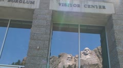Reflection of Mount Rushmore in the Visitor Center Stock Footage