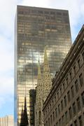 Manhattan Contrast Cathedral and Skyscraper - stock photo