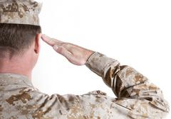 Marine In Desert Fatigues Saluting Stock Photos