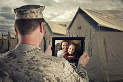 Deployed Military Man Chats With Family on Computer Stock Photos