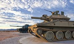 Stock Photo of Two Retro Tanks at Sunrise