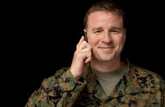 Soldier Calls Home on Cell Phone Stock Photos