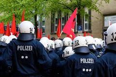 Police Officers Face Protesters - stock photo