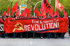 Protesters March with Red Banners - stock photo