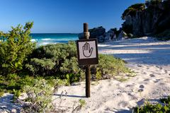 Sign with a Hand Pictograph at Beach - stock photo