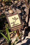 Spanish English Caution Slippery Sign - stock photo