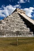 Wide-Angle View of Kukulkan Pyramid at Chichen Itza - stock photo