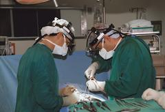 two surgeons operating - stock photo