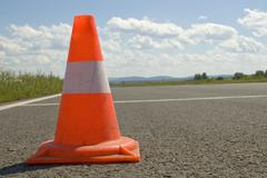 Cone on a road. Stock Photos