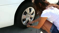 Checking tire pressure and adding air Stock Footage