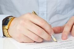 Stock Photo of businessman signing agreement
