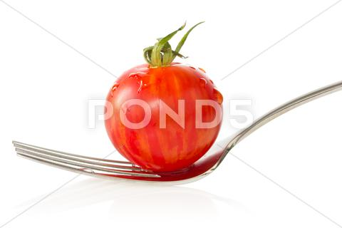 Stock photo of cherry tomato on a fork