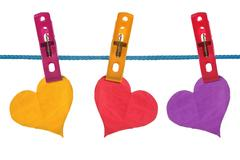 color paper hearts hung on clothesline - stock photo