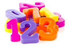 Colorful assorted plastic numbers Stock Photos