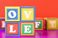 "Stock Photo of word ""love"" made from baby blocks"