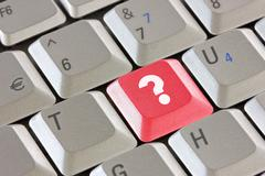 computer keyboard with  question key - stock photo