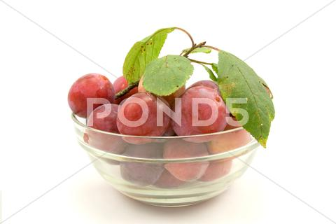 Stock photo of dish with plums