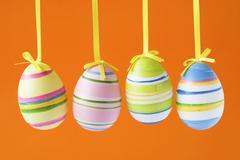 easter eggs isolated on orange background - stock photo