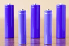 purple alkaline batteries - stock photo