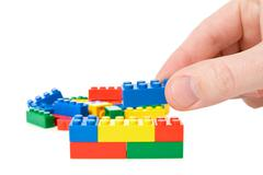 Hand build a color plastic  bricks Stock Photos