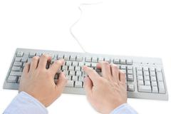 Stock Photo of hands typing on a  computer keyboard