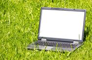 Stock Photo of laptop on the grass
