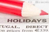 Stock Photo of newspaper  with holidays ad