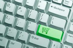 keyboard button with symbol of shopping cart - stock photo