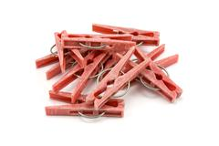pile of plastic clothes pegs - stock photo