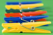 Stock Photo of row of colorful clothespins