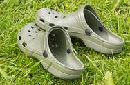 Stock Photo of rubber sandals on a grass