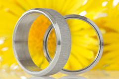 silver rings with yellow flowers - stock photo