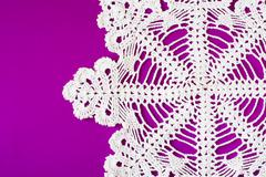 Stock Photo of white decorative serviette on purple background