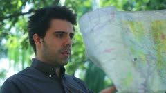 Desheveled lost man map Stock Footage