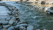 Mountainriver in the Alps in France, boulders, rocks and mountains Stock Footage
