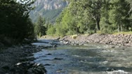 Wild river in mountains flowing downstream in the Alps in France Stock Footage