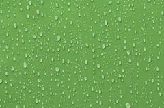 Water droplets on green background Stock Photos