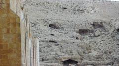 Monks' cells in the rock of Kidron valley, Saint Savas monastery near Jerusalem, Stock Footage