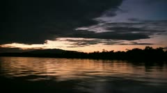 Gorgeous jungle footage taken at dusk of a speeding boat Stock Footage
