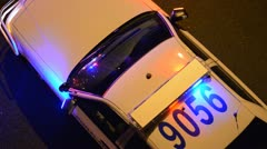 Police car with emergency Lights on Stock Footage
